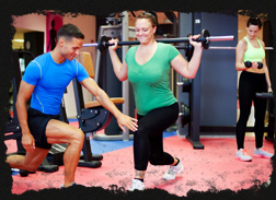 Gym Instructor and Gym Member in a Personal Training Session